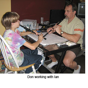 Don working with Ian