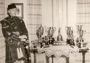 A young Dad with trophies